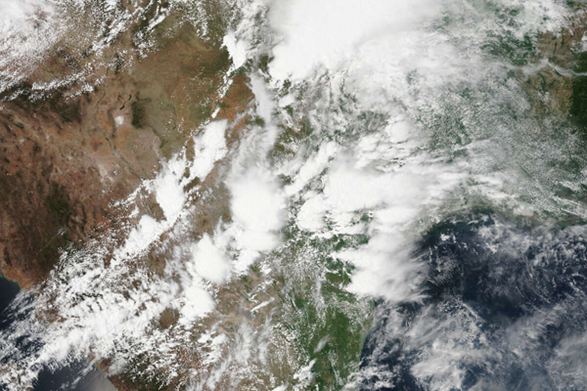 This NOAA/NESDIS satellite image shows Texas on Saturday, May 23, 2015. Somewhere under this big storm system is the Lone Star State, getting pounded by rain.