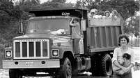 07/26/1979 - Alvin residents are carried out by a dump truck as they leave their flooded subdivision on the southwest side of Alvin. Many Alvin residents were forced to flee their homes as floodwaters caused by torrential rains from Tropical Storm Claudette continued to rise.