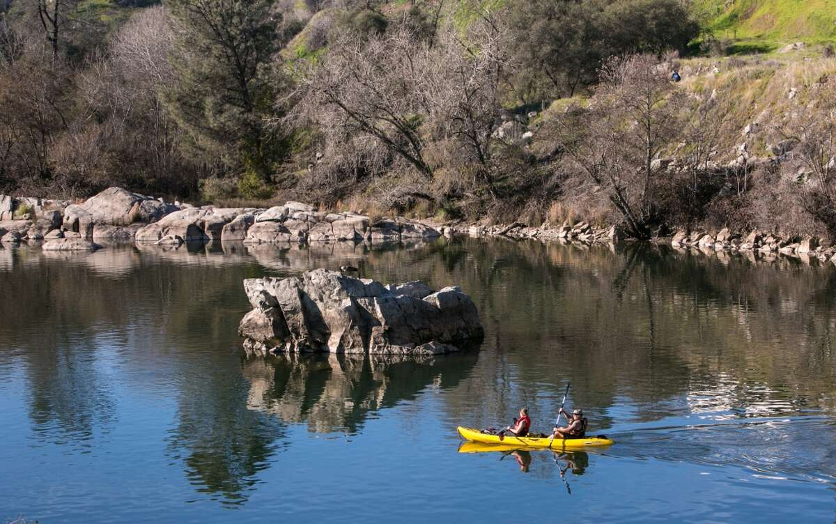FOLSOM, CA - JANUARY 28: Kayakers paddle along the American River near the downtown Historic District as viewed on January 28, 2015 in Folsom, California. L(Photo by George Rose/Getty Images)