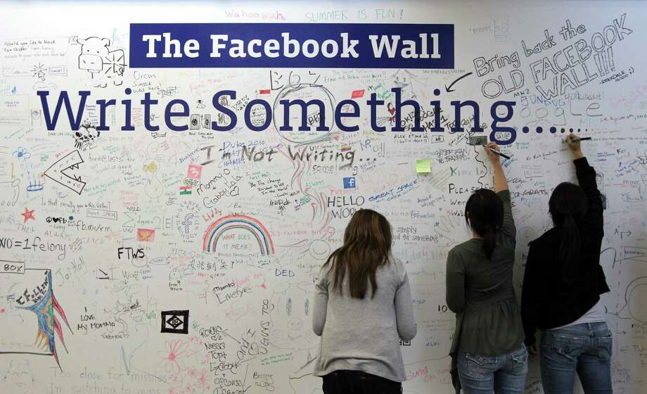 "PALO ALTO, CA - AUGUST 18:  Facebook employees write on the Facebook ""wall"" following a news conference at Facebook headquarters August 18, 2010 in Palo Alto, California. Facebook founder and CEO Mark Zuckerberg announced the launch of Facebook Places, a new application that allows Facebook users to document places they have visited. Photo: Justin Sullivan, Getty Images / 2010 Getty Images"