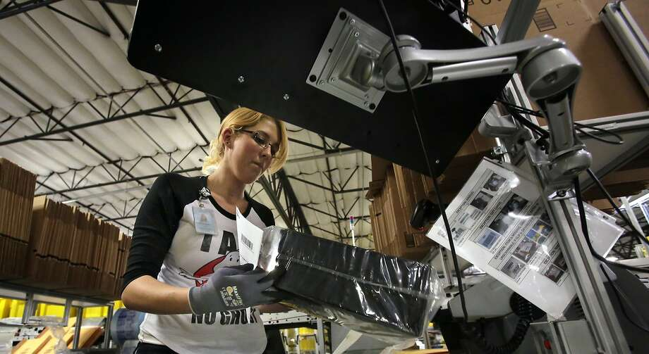Kathleen Jelly fills an order at Amazon's warehouse in San Bernardino in 2013. Expect deals Wednesday. Photo: Irfan Khan, McClatchy-Tribune News Service