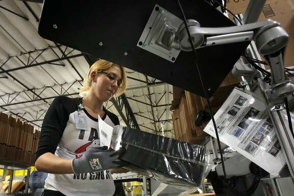 Amazon Prime shoppers who make a purchase of $35 or more by noon can get their items that day at no extra cost. Above, Kathleen Jelly fills an order at Amazon's Fulfillment Center in San Bernardino, Calif. (Irfan Khan/Los Angeles Times/TNS)