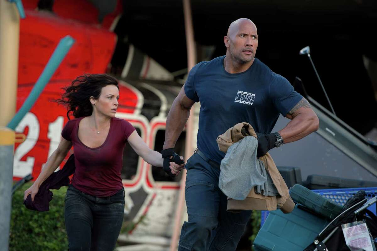 Carla Gugino as Emma and Dwayne Johnson as her ex-spouse, Ray, flee the destruction in action thriller