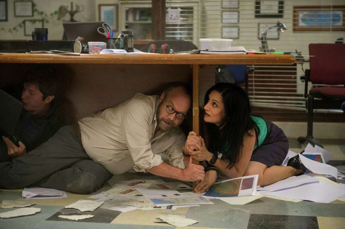 Paul Giamatti as Lawrence and Archie Panjabi as Serena take cover as the quakes roll terrifyingly across the big screen.