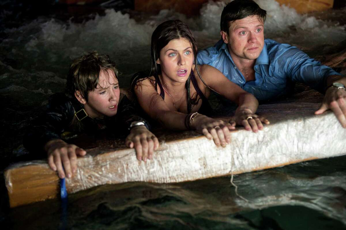 Art Parkinson as Ollie (left), Alexandra Daddario as Blake and Hugo Johnstone-Burt as Ben struggle to survive the destruction as quakes pulverize most of California.