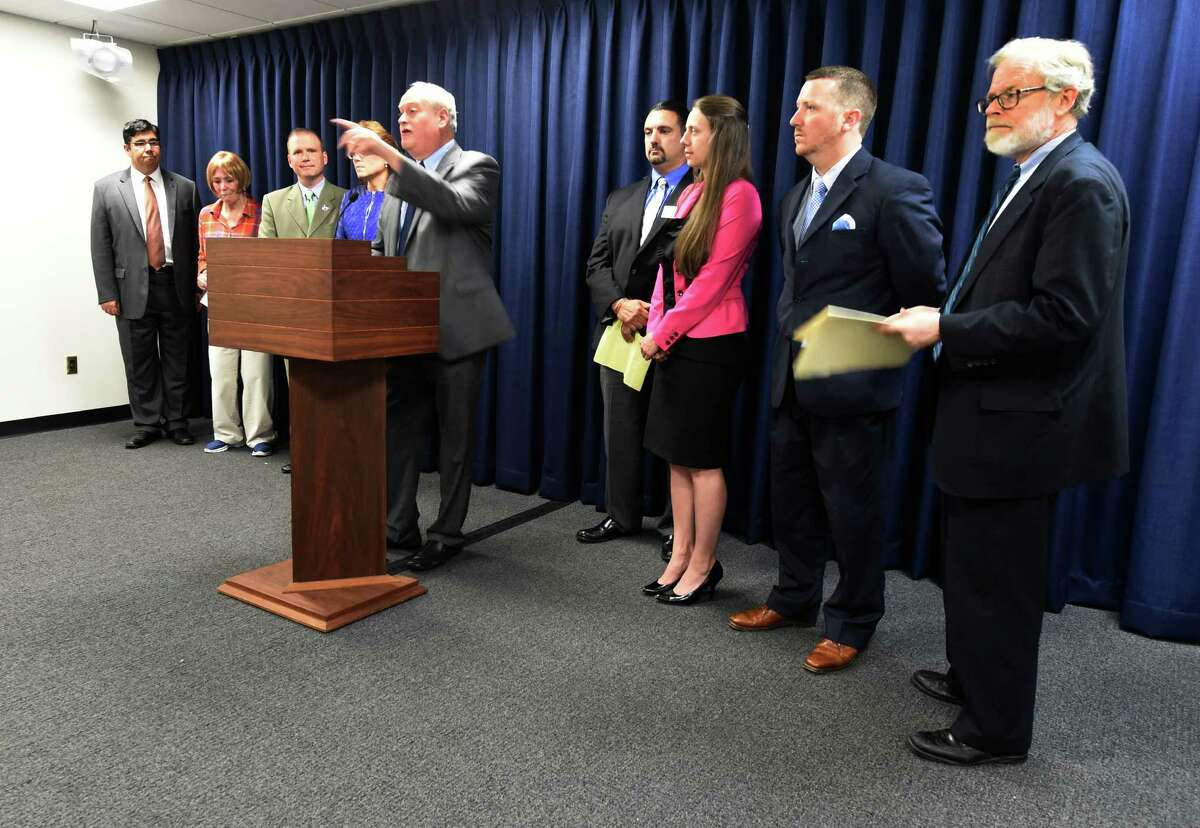 Glenn Liebman, CEO Mental Health Association of NYS, center, leads a group of representatives from a variety of patient and provider groups across New York that came to the Capitol Thursday May 28, 2015 in Albany, N.Y. to urge lawmakers to support legislation aimed at ensuring patients will not have to wait for the medication that their doctors have prescribed in a process known as Ostep therapyO or Ofail firstO (Skip Dickstein/Times Union)