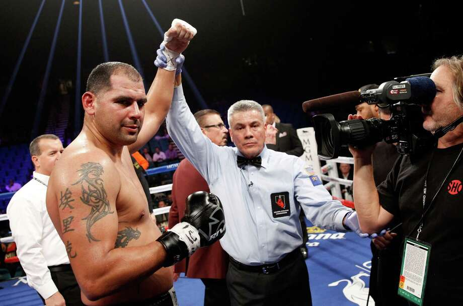 Eric Molina has his arm raised by referee Russell Mora after beating Raphael Zumbano in a heavyweight fight at the MGM Grand Garden Arena in Las Vegas on Jan. 17, 2015. Molina won with an eighth-round TKO. Photo: Steve Marcus /Getty Images / 2015 Getty Images