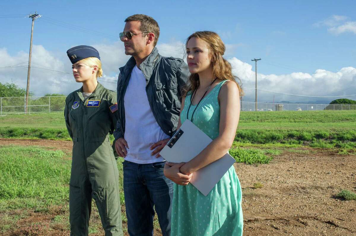"""This photo provided by Sony Pictures Entertainment shows, from left, Emma Stone, Bradley Cooper, and Rachel McAdams, in a scene from Columbia Pictures' """"Aloha."""" The movie releases in U.S. theaters on May 29, 2015. (Neal Preston/Sony Pictures Entertainment via AP) ORG XMIT: CAET643"""