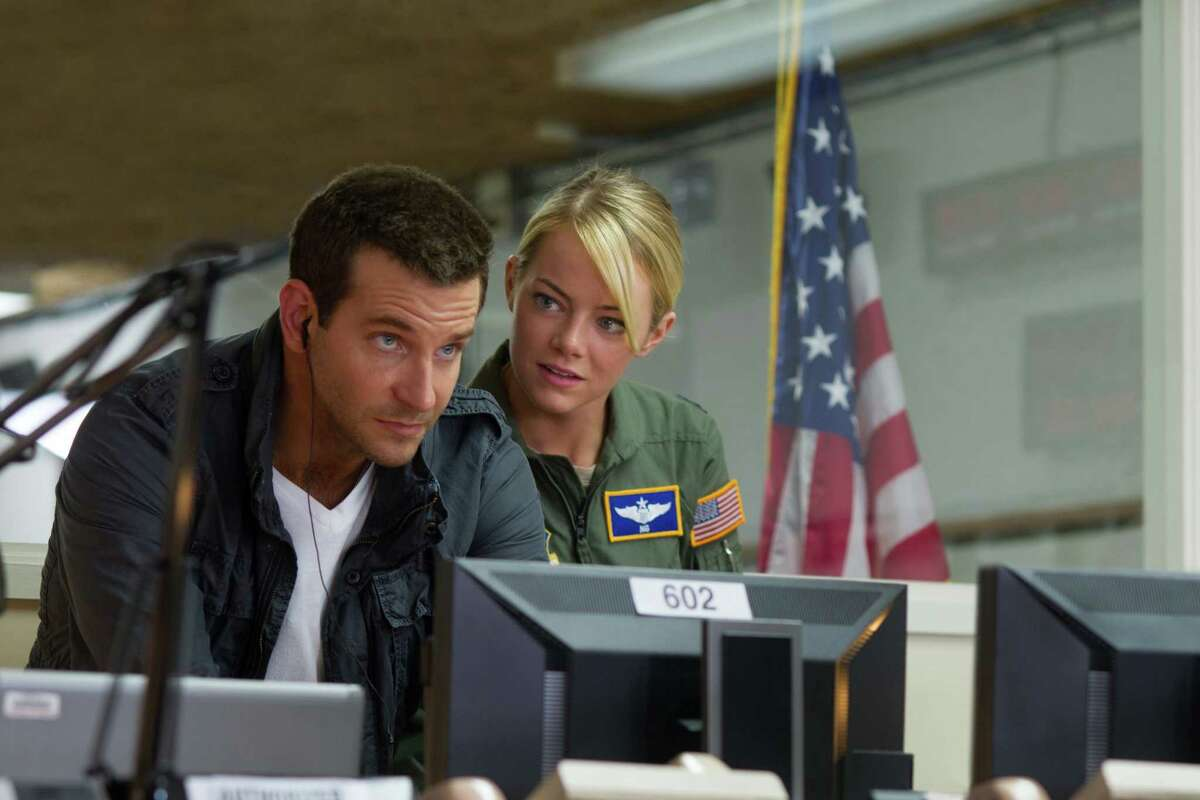 """This photo provided by Sony Pictures Entertainment shows, Bradley Cooper, left, and Emma Stone, in a scene from Columbia Pictures' """"Aloha."""" The movie releases in U.S. theaters on May 29, 2015. (Neal Preston/Sony Pictures Entertainment via AP) ORG XMIT: CAET639"""
