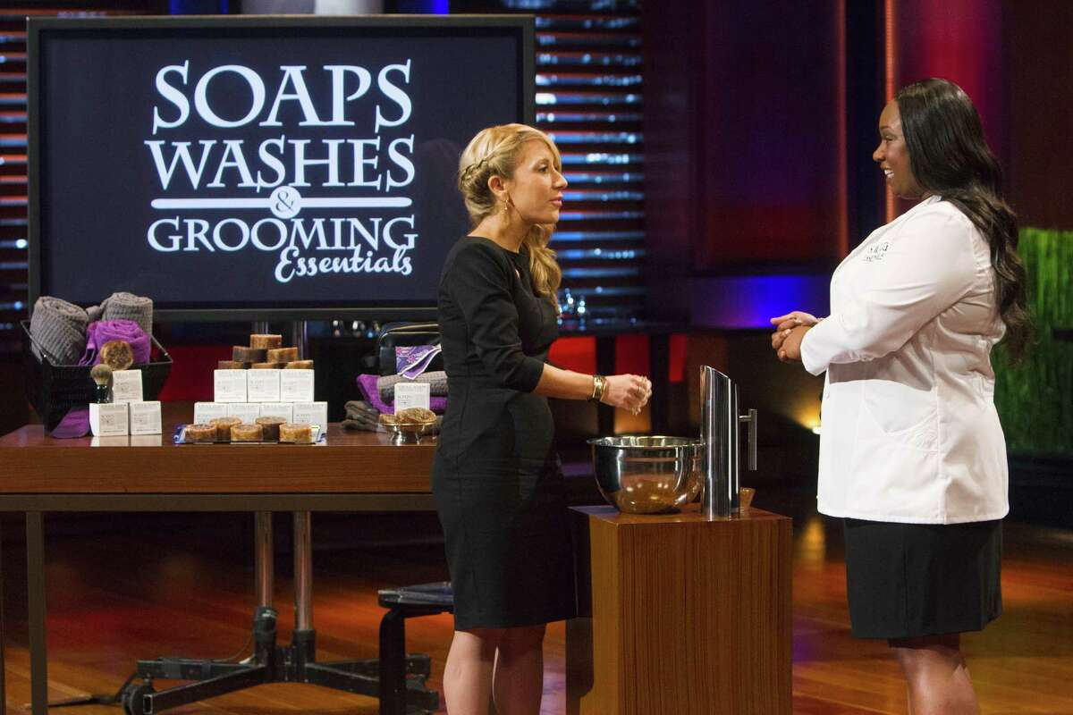 """SHARK TANK - Houstonian Lydia Evans makes soaps, washes and grooming products and pitched her SWAG cleansing bar on """"Shark Tank"""" on Dec. 5, 2014. SHARK TANK - """"Episode 613"""" - A Brooklyn man tries to interest the Sharks in his family-run business of foldable, wheeled luggage; a single woman from Houston, Texas, makes soaps, washes and grooming products, but will she clean up with a deal? A couple from Sapulpa, Oklahoma has a fashion-forward line of gameday apparel for women geared towards college teams, and an entrepreneur from Scarsdale, NY pitches his single serve wine product that comes in recyclable plastic. And Lori Greiner gives an update on her """"All-Stars"""" with Scrub Daddy, Screen Mend, Drop Stop, Fiber Fix, Readerest and Invisiplug on FRIDAY, DECEMBER 5 (9:00-10:01 p.m., ET) on the ABC Television Network. (ABC/Adam Rose) LORI GREINER, LYDIA EVANS (S.W.A.G. ESSENTIALS)"""