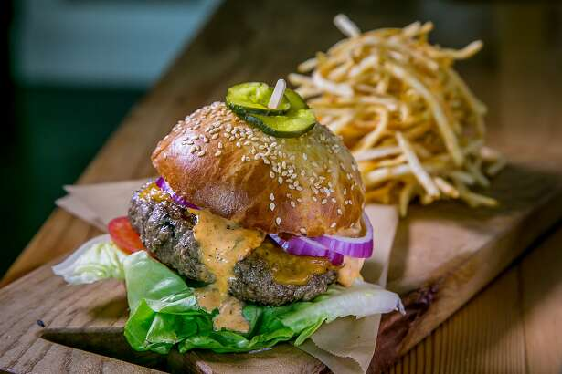 The Burger with Fries at Rusty's Southern BBQ in San Francisco Calif., is seen on May 27th, 2015.