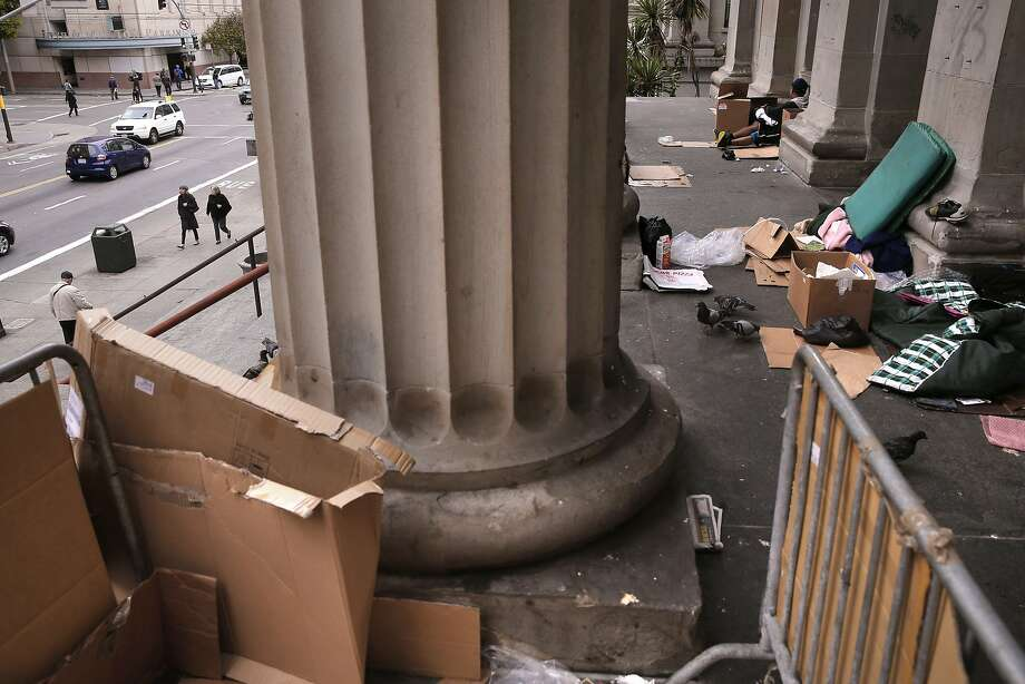 The homeless have set up living on the steps of the old United States Mint building on Mission St. as seen on Thurs. May, 28, 2015,  San Francisco, Calif. San Francisco, which thinks it is a world class city measures up against cities like New York and London but has problems it ignores, like street beggars, dirty streets and trash. Photo: Michael Macor, The Chronicle