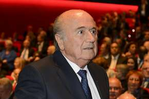 """FIFA President Sepp Blatter arrives for the opening ceremony of the 65th FIFA Congress in Zurich on May 28, 2015. FIFA president Sepp Blatter said on May 28 that the scandal-tainted football body faces """"more bad news"""" and that officials accused of corruption had brought shame and humiliation on the organisation. But the 79-year-old Swiss official told the opening of FIFA's annual congress he could not be blamed for the latest controversy to hit the body saying he could not """"monitor"""" every official. AFP PHOTO / FABRICE COFFRINIFABRICE COFFRINI/AFP/Getty Images"""