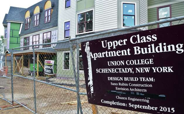 Work continues on Union College's three-story apartment-style residence on Roger Hull Place and Park Place Wednesday May 27, 2015 in Schenectady, NY. The 80-bed building will consist of fully furnished four-, three-and two-bedroom apartments. Each apartment has common living space (kitchen and living room), two bathrooms and closets.  (John Carl D'Annibale / Times Union) Photo: John Carl D'Annibale / 00032003A