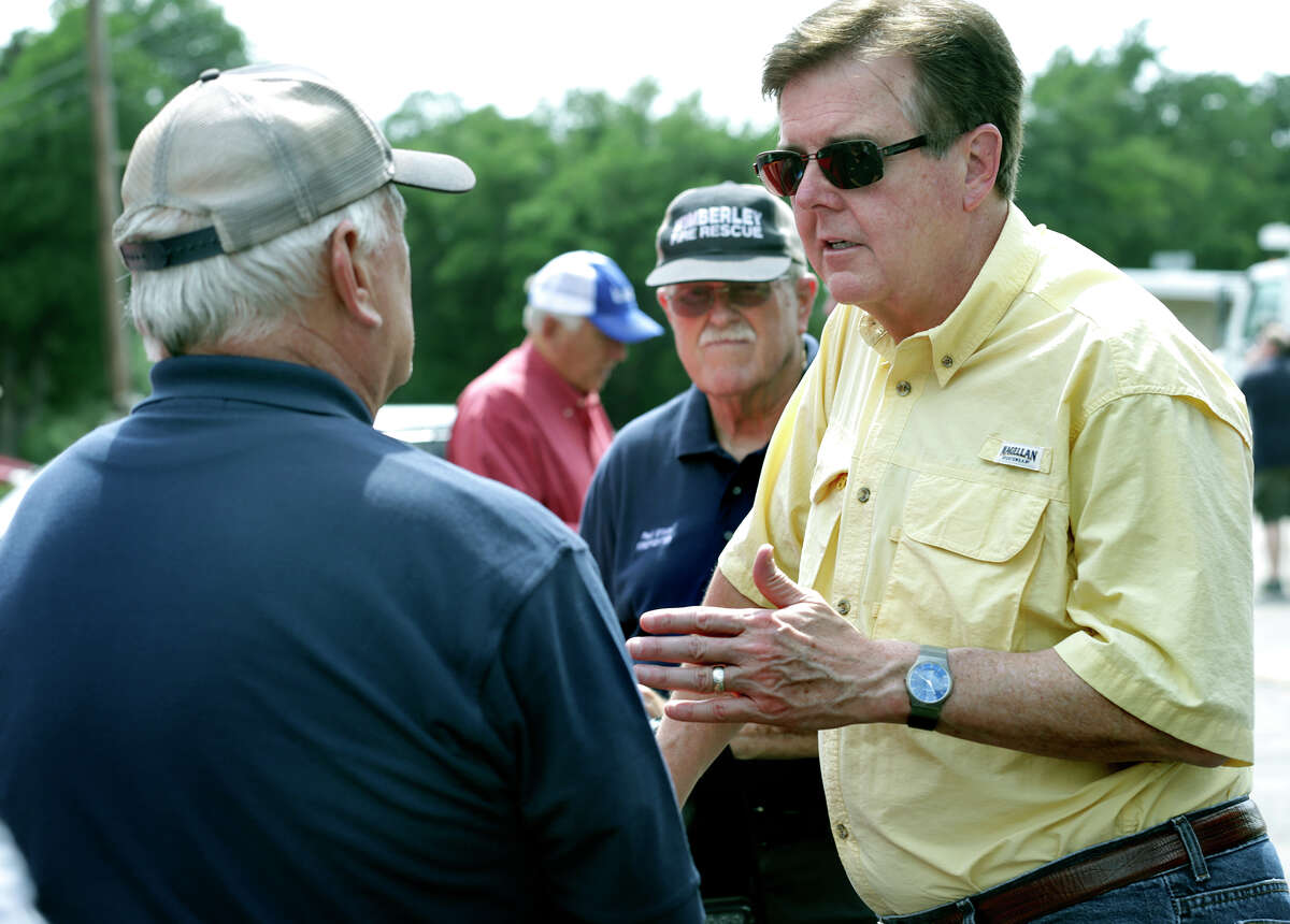 Lt. Gov. Dan Patrick, right, speaks to Wimberley Fire Chief Carroll Czichos after touring the flooded area in Wimberley, TX by helicopter on Thursday, May 28, 2015.