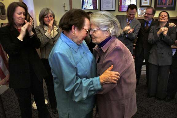 Phyllis Lyon, left, and Del Martin, who have been together for 51 years, embrace after their marriage at City Hall in 2004. They were the first legally married same-sex couple in San Francisco.