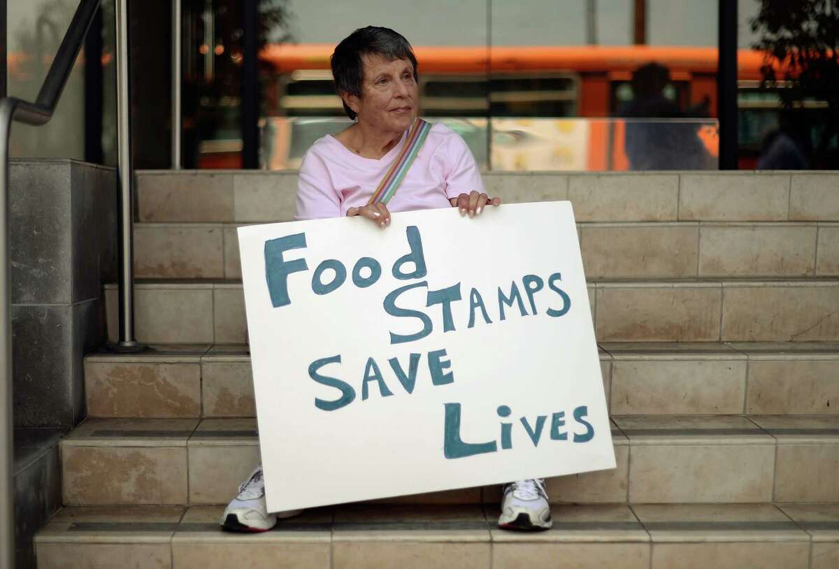 LOS ANGELES, CA - JUNE 17: Members of Progressive Democrats of America and other activists hold a rally in front of Rep. Henry Waxman's office on June 17, 2013 in Los Angeles, California. The protestors were asking the congressman to vote against a House farm bill that would reduce federal spending on the Supplemental Nutritional Assistance Program by $20.5 billion and affect food stamps and other services for the poor. (Photo by Kevork Djansezian/Getty Images)