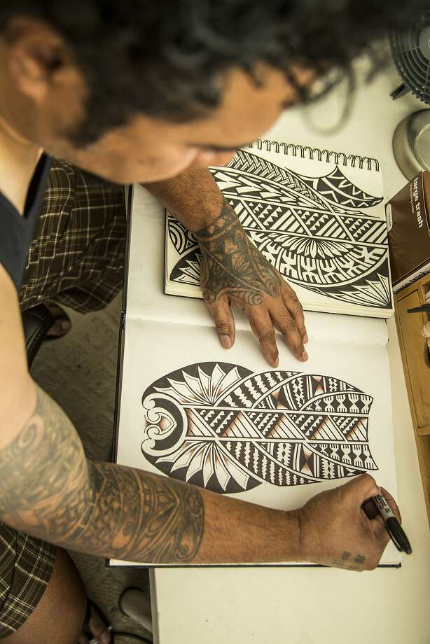 Fijian tattoo artist Lomani Gaunavinaka of Santa Rosa sketches tattoo designs. Pacific Worlds exhibit at the Oakland Museum of California Photo: Jean Melesaine Photo: Jean Melesaine