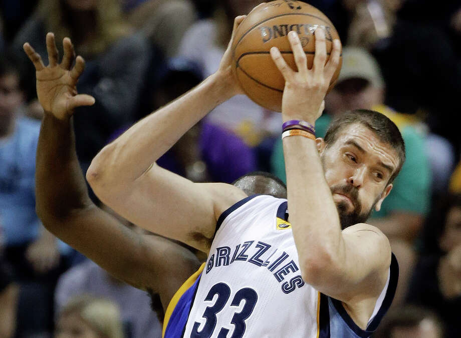 In this photo taken May 15, 2015, Memphis Grizzlies center Marc Gasol, of Spain, drives to the basket in Game 6 of a second-round Western Conference playoff series against the Golden State Warriors in Memphis, Tenn. The Grizzlies' season ended when the Warriors won 108-95 to win the series 4-2. Now the Grizzlies have to convince Gasol, a free agent, that Memphis is where he should stay. Photo: Mark Humphrey /Associated Press / AP