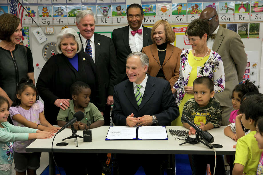 Texas Gov. Greg Abbott smiles as he signs into law a pre-K boost that was among his top campaign promises but has underwhelmed educators Thursday, May 28, 2015, in Austin, Texas. (Ralph Barrera/Austin American-Statesman via AP)  AUSTIN CHRONICLE OUT, COMMUNITY IMPACT OUT, INTERNET AND TV MUST CREDIT PHOTOGRAPHER AND STATESMAN.COM, MAGS OUT   RALPH BARRERA/ AMERICAN-STATESMAN Photo: Ralph Barrera,  MBO / Associated Press / Austin American-Statesman
