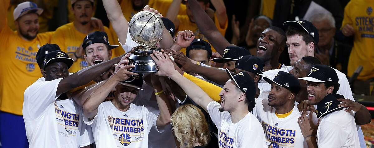 Warriors are headed to the NBA finals. Golden State Warriors' Stephen Curry and teammates hold Western Conference trophy after defeating Houston Rockets 104-90 in Game 5 of NBA Playoffs' Western Conference Finals at Oracle Arena in Oakland, Calif., on Wednesday, May 27, 2015.