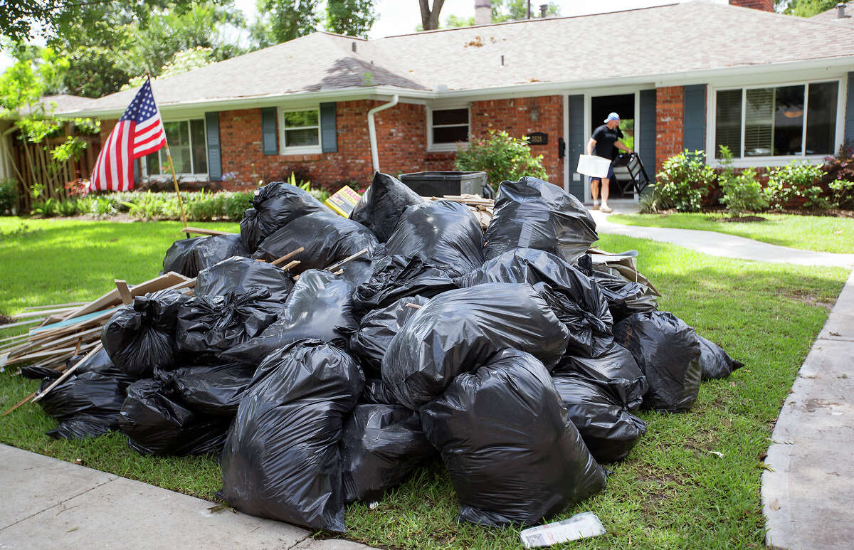 Matthew Smith cleans out his home on Thursday after, May 28, 2015, after it flooded in Houston.