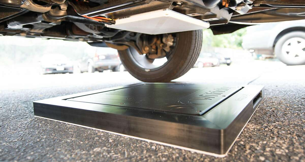 WiTricity's technology uses an oscillating magnetic field to recharge the batteries of electric cars or plug-in hybrids, with no plugging in required.