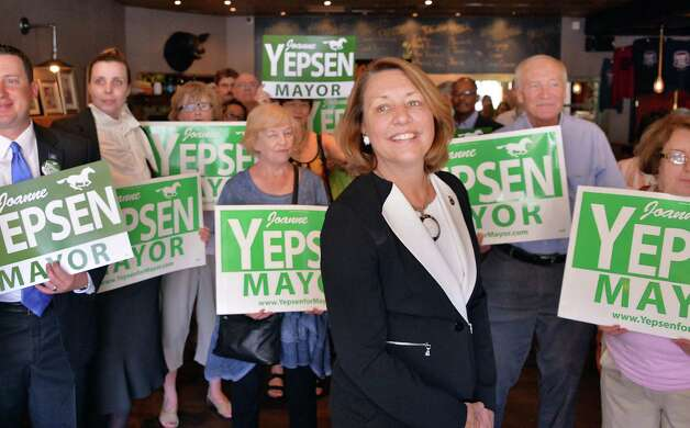Saratoga Springs Mayor Joanne Yepsen, center, is joined by supporters as she announces her re-election campaign Thursday May 28, 2015, at a news conference in Saratoga Springs, N.Y.  (John Carl D'Annibale / Times Union) Photo: John Carl D'Annibale / 00032042A