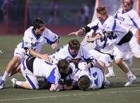 Darien High School lacrosse team celebrate after winning Thursday evening FCIAC Finals against Ridgefield High School. Darien won 9-5