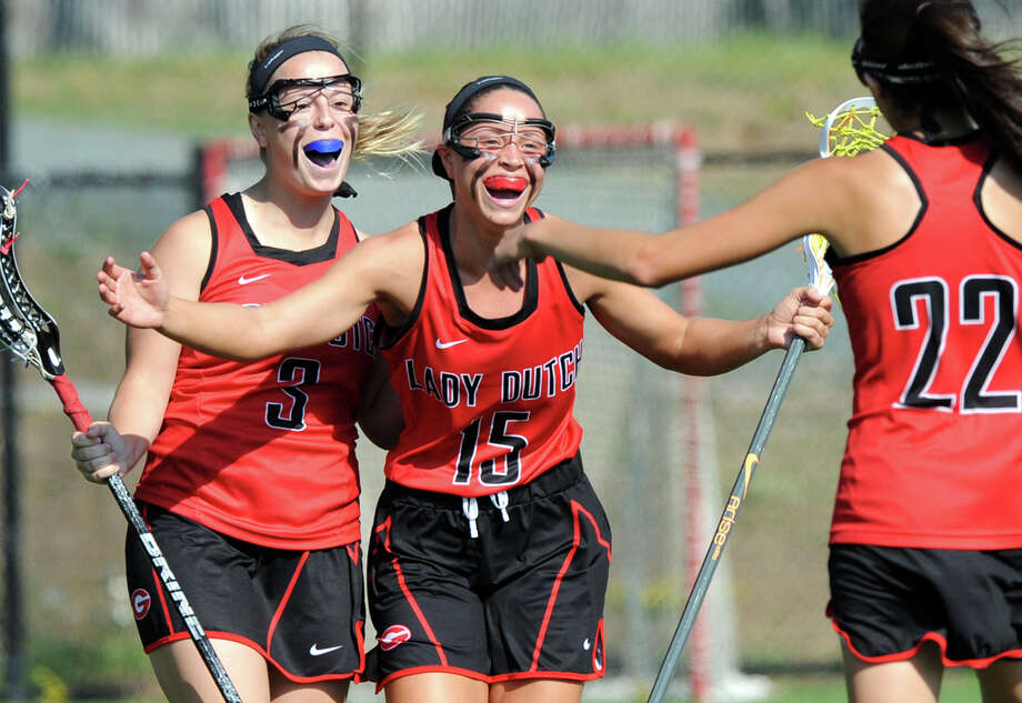 Guilderland's Cara Quimby, #15 center, celebrates one of her nine goals during their 17-7 victory over Shenendehowa in the Section II Class A girls' high school lacrosse championship at UAlbany John Fallon Field on Thursday May 28, 2015 in Albany, N.Y. (Michael P. Farrell/Times Union) Photo: Michael P. Farrell / 00031970A