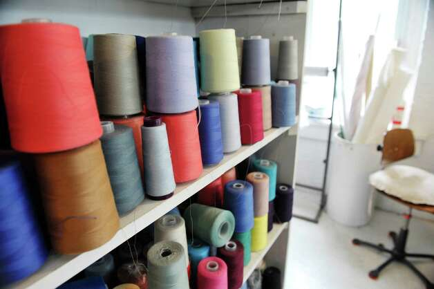 A view of thread on a shelf inside the Ursula of Switzerland building on Tuesday, May 26, 2015, in Waterford, N.Y.  The dress manufacturer is housed in an old ribbon factory.      (Paul Buckowski / Times Union) Photo: PAUL BUCKOWSKI / 00031965A