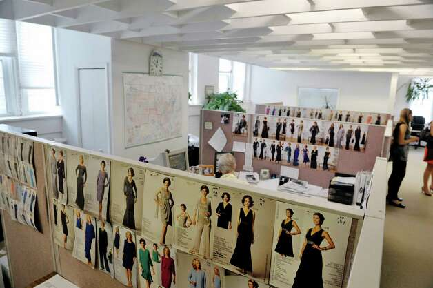 A view of customer service area inside the Ursula of Switzerland building on Tuesday, May 26, 2015, in Waterford, N.Y.  Images of each dress in the current line are posted on the walls for customer service representatives.  The dress manufacturer is housed in an old ribbon factory.      (Paul Buckowski / Times Union) Photo: PAUL BUCKOWSKI / 00031965A