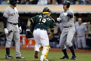 A's rally to topple Yankees 5-4 - Photo
