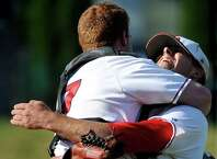 Albany Academy's pitcher Brooks Knapek, right, and catcher Sean Dempsey celebrate their 7-0 win over Schuylerville in the Class B baseball final on Thursday, May 28, 2015, at Joe Bruno Stadium in Troy, N.Y. (Cindy Schultz / Times Union)