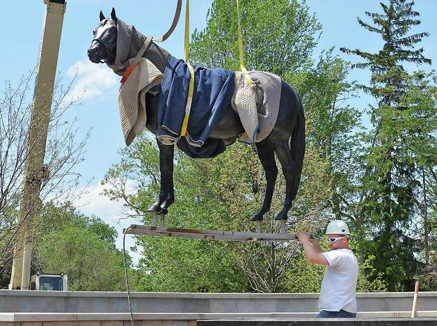 Bonacio Construction site supervisor Jack Hopkins guides a statue of Storm Cat into position at OCentennial ParkO at the end of Union Avenue Thursday May 28, 2015 in Saratoga Springs, NY.  The statue will remain until Aug 1, when a Native Dancer and rider statue will take its place in the permanent park.  (John Carl D'Annibale / Times Union) Photo: John Carl D'Annibale / 00032036A