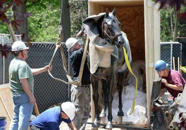 Workers from Bonacio Construction prepare a statue of Storm Cat for installation at OCentennial ParkO at the end of Union Avenue Thursday May 28, 2015 in Saratoga Springs, NY.  The statue will remain until Aug 1, when a Native Dancer and rider statue will take its place in the permanent park.  (John Carl D'Annibale / Times Union) Photo: John Carl D'Annibale / 00032036A