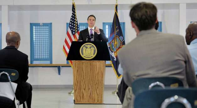 Governor Andrew Cuomo talks about the incarceration of 16 and 17 year olds during a press conference following a tour the Governor took at the Greene Correctional Facility on Thursday, May 28, 2015, in Coxsackie, N.Y.     (Paul Buckowski / Times Union) Photo: PAUL BUCKOWSKI / 00032056A