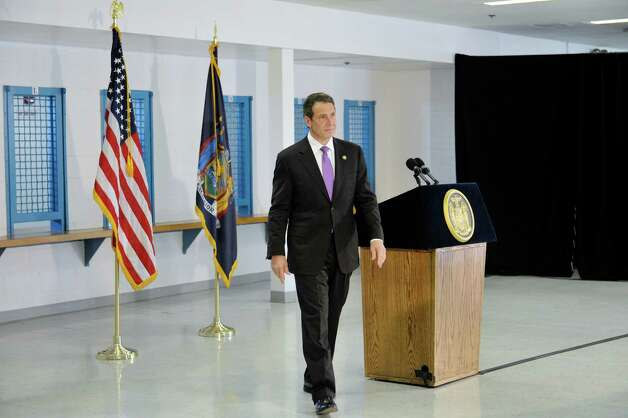Governor Andrew Cuomo walks away from the podium at the end of a press conference at the Greene Correctional Facility on Thursday, May 28, 2015, in Coxsackie, N.Y.   The Governor took a tour of the facility earlier.   (Paul Buckowski / Times Union) Photo: PAUL BUCKOWSKI / 00032056A
