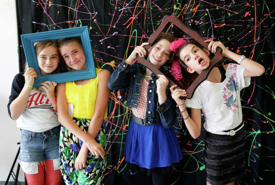 Fifth graders Lily Wise, Emma Ogier, Claudia Van Ek, and Erin Earthman, all 11, pose for photo booth photos at Travis Elementary School as they celebrate their last day of school and the last day of school for the Houston Independent School district on Thursday, May 28, 2015, in Houston. Photo: Karen Warren, Houston Chronicle / © 2015 Houston Chronicle