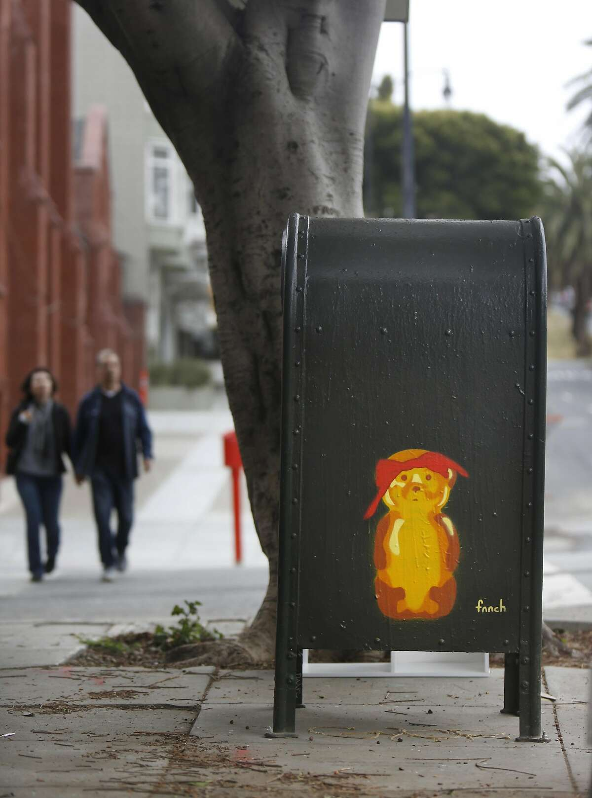 A honey bear on a mailbox by street artist Fnnch is seen on the corner of 19th and Dolores Streets on Wednesday, May 27, 2015 in San Francisco, Calif.