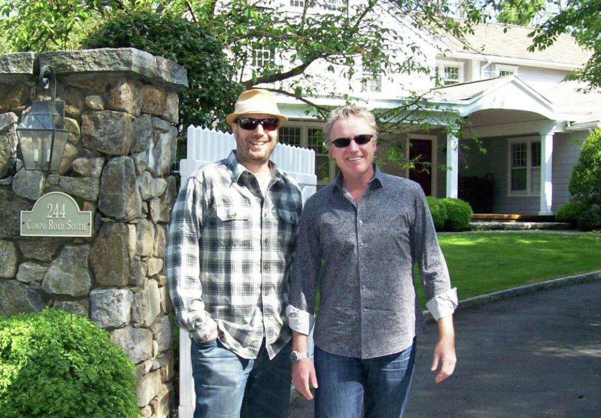 Robert Steven Williams, left, and Deej Webb are producing a documentary film about F. Scott Fitzgerald that will be screened at the Fairfield Theatre Company in Fairfield. Williams and Webb are standing in front of the Compo Road South house where Fitzgerald and his wife, Zelda, lived from May until early October 1920.