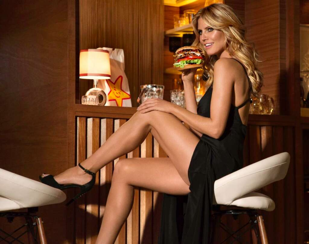 Heidi Klum eats a Carl's Jr. burger.