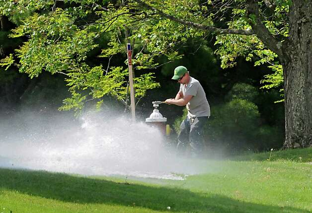 Guilderland Parks Department employee Andrew Huggins flushes out a hydrant at Tawasentha Park on Wednesday, May 27, 2015 in Guilderland, N.Y.  (Lori Van Buren / Times Union) Photo: Lori Van Buren, Albany Times Union