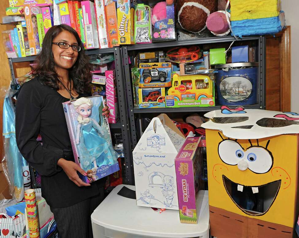 Fazana Saleem-Ismail stands in her basement with some of the donated party supplies she uses to throw birthday parties for homeless children on Wednesday, May 27, 2015 in Schenectady, N.Y. Fazana founded the nonprofit organization Jazzy Sun Birthdays in order to give kids who are living in shelters a sense of normalcy with real birthday parties. This(Lori Van Buren / Times Union)
