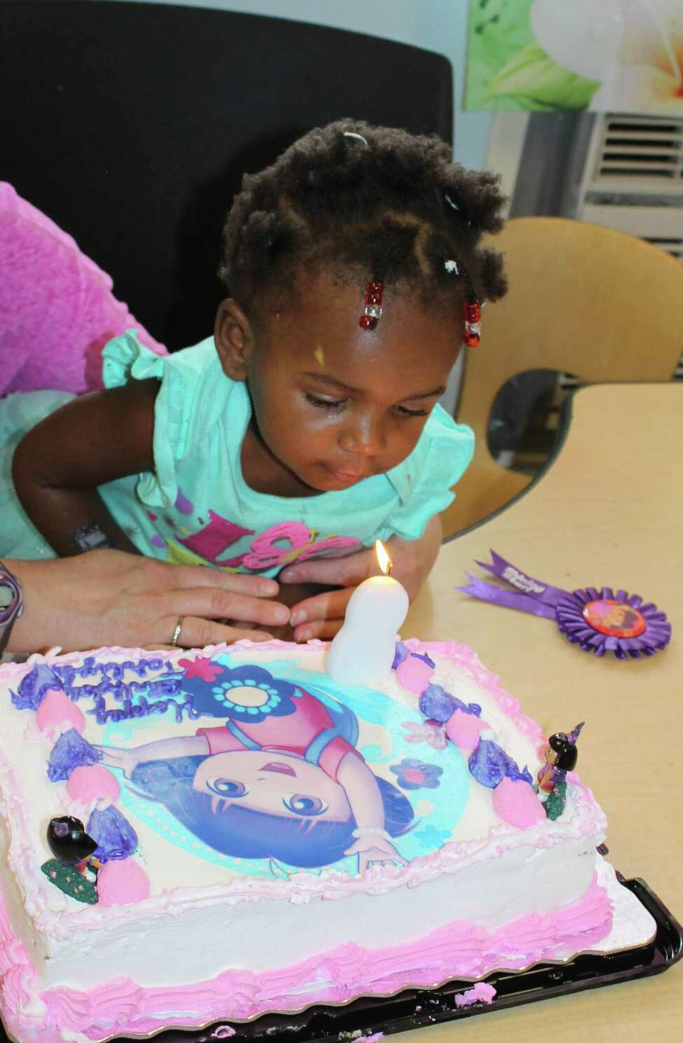 Jazzy Sun Birthdays, a program that throws birthday parties for children in homeless shelters, provides gifts and a cake for every birthday child. (Jazzy Sun Birthdays)
