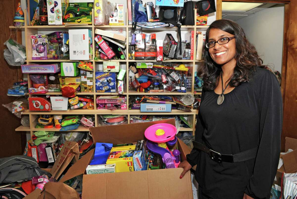 Fazana Saleem-Ismail stands in her basement with some of the donated party supplies she used to throw birthday parties for homeless children on Wednesday, May 27, 2015 in Schenectady, N.Y. Fazana founded the nonprofit organization Jazzy Sun Birthdays in order to give kids who are living in shelters a sense of normalcy with real birthday parties. (Lori Van Buren / Times Union)