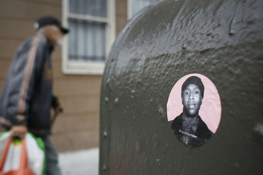 A #lastblackman sticker is displayed on a mailbox in San Francisco's Mission District. Photo: Mike Kepka, The Chronicle