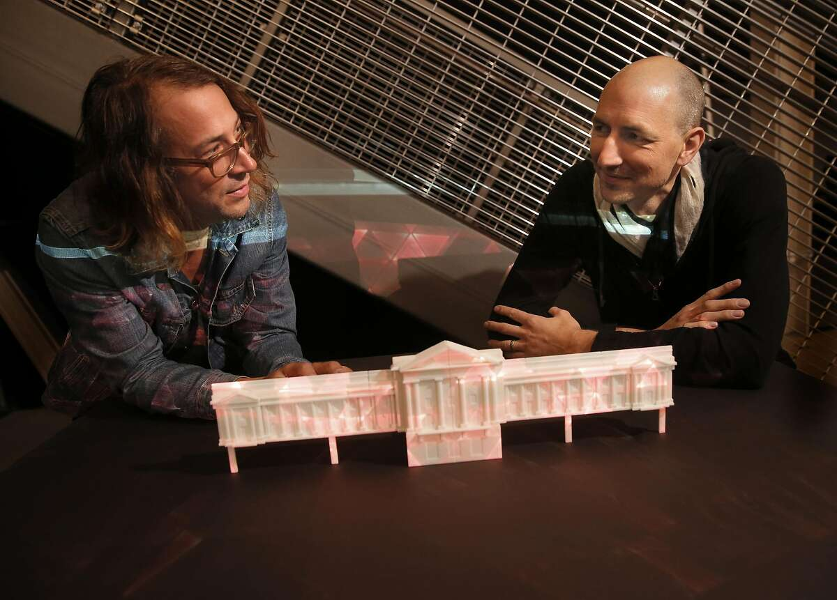 Co-Founder and Chief Creative Officer, Travis Threlkel, (left) and Chris Lejeune, Co-Founder and CEO of Obscura, a light technology installation company, with a scale model of San Francisco City Hall they are using to design an upcoming production to celebrate the building's 100th anniversary, as seen at their offices in San Francisco, Calif. on Thurs. May, 28, 2015.