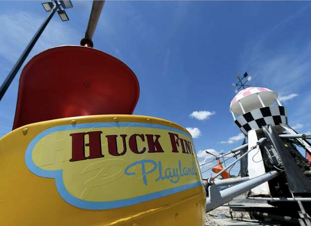 A renovated helicopter ride with the new logo sits ready and waiting for a few young pilots at the Huck Finn's Playland as work continues on the site north of Huck Finn's Warehouse Friday afternoon May 29, 2015 in Albany, N.Y.    (Skip Dickstein/Times Union) Photo: SKIP DICKSTEIN / 00032077A