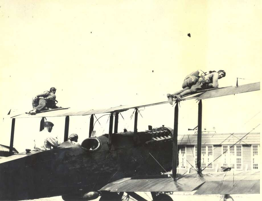 Two paratroopers are shown strapped to the top of the wings of their plane at Brooks Field in this 1924 photo. Photo: Courtesy / U.S. Air Force